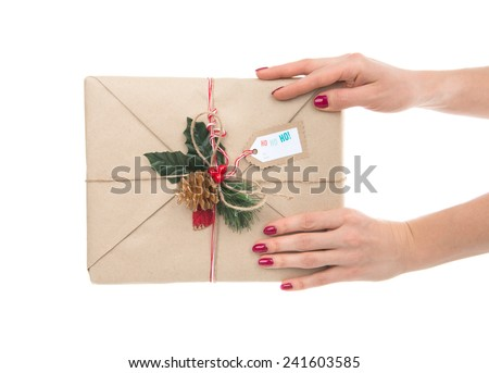 Vintage handmade craft christmas or rustic birthday present gift in hands isolated on a white background - stock photo