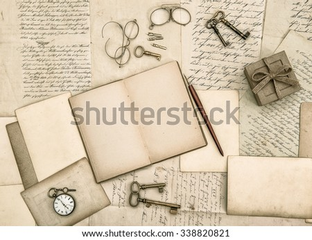 Vintage handwriting and antique office tools. Nostalgic paper background - stock photo