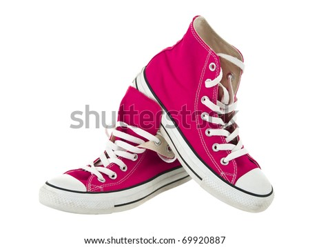 Vintage hanging pink shoes on pure white background