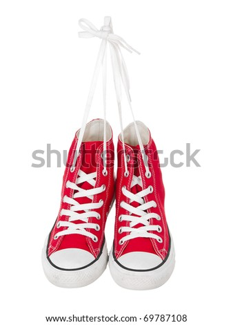 Vintage hanging red shoes on pure white background - stock photo