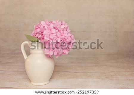 Vintage Hazy Pink Hydrangea with a rustic wood background with rom for copy. - stock photo