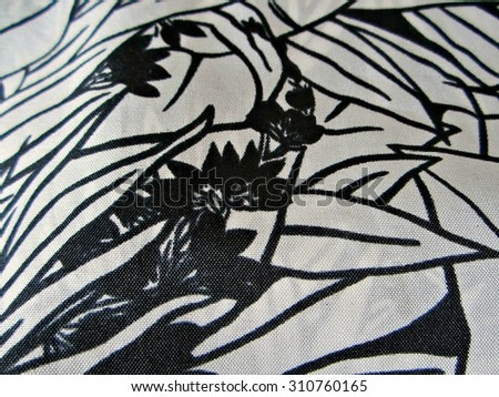 Vintage head scarf or large handkerchief with bold black and white tropical design. Detailed image of real silk scarf. - stock photo