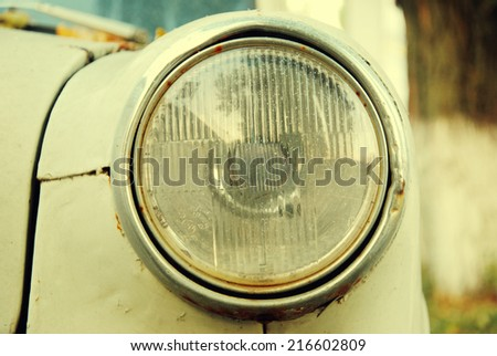 Vintage Headlight Of The Abandoned Car - stock photo