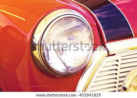vintage headlight red car, retro style - stock photo