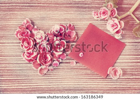 Vintage heart from flowers on wooden table/ Valentines day background - stock photo