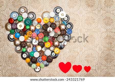 Vintage heart of the buttons and little red hearts made of paper on linen scarf. Valentine's Day Concept - stock photo