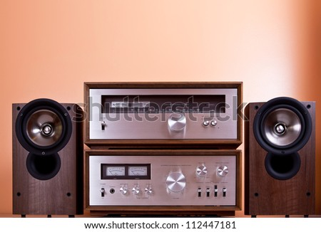 Vintage hi-fi Stereo Amplifier tuner and speakers in wooden cabinets, front - stock photo