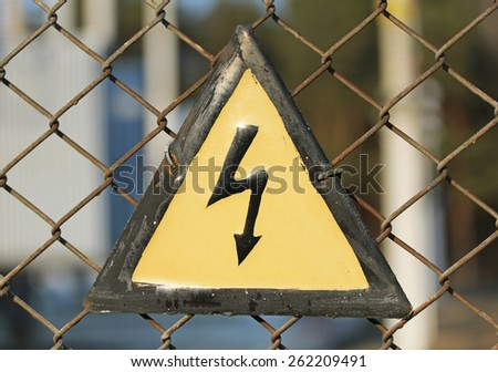 Vintage high voltage caution sign close up - stock photo