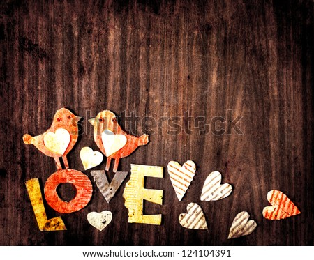 """Vintage holidays card with a two birds and hearts  as a symbol of love/valentines day card with word """"love"""" - stock photo"""