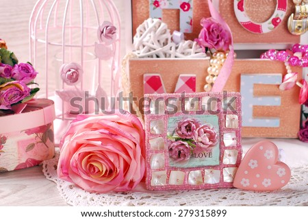 vintage home still life with beautiful photo frame,rose and wooden drawers box in romantic style - stock photo
