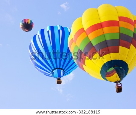 Vintage hot air balloons in flight - stock photo