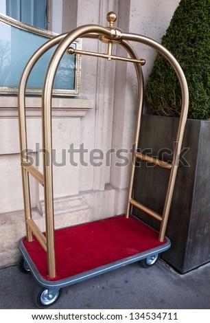 Vintage hotel baggage cart. - stock photo