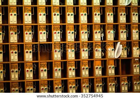 Vintage hotel front desk key rack. - stock photo