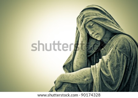 Vintage image of a marble statue representing a suffering religious woman - stock photo
