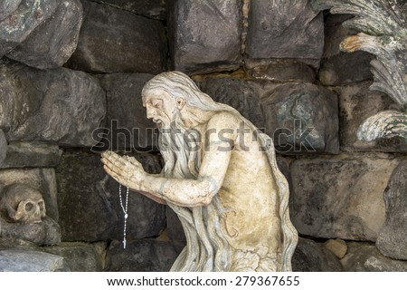 Vintage image of a suffering religious man with a crucifix - stock photo