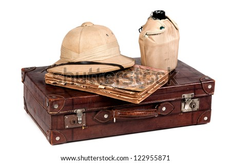 Vintage image of an explorer's hat, canteen and old suitcase