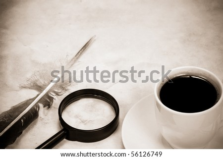 vintage image of feather and magnifying glass - stock photo