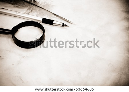 vintage image of old pen and feather