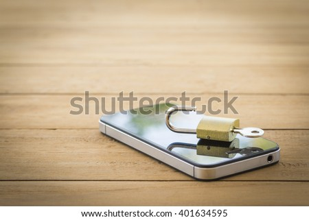 vintage image of padlock on mobile,smart phone,tablet,cell phone ,still life,safety privacy data and business data in mobile concept - stock photo