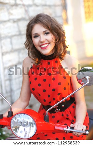 Vintage image of young attractive girl and the old scooter - stock photo