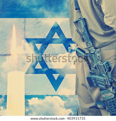 Vintage image.Soldier of Israeli defense forces on Israeli national flag wall and sky background with burning candle  - stock photo
