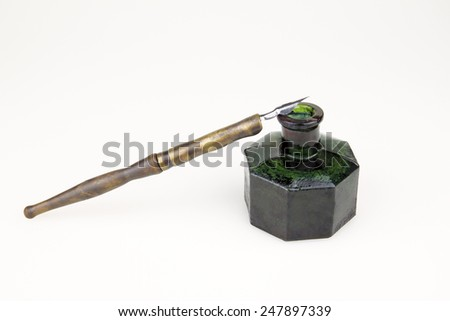 vintage  ink pen  and old glass inkwell  isolated - stock photo