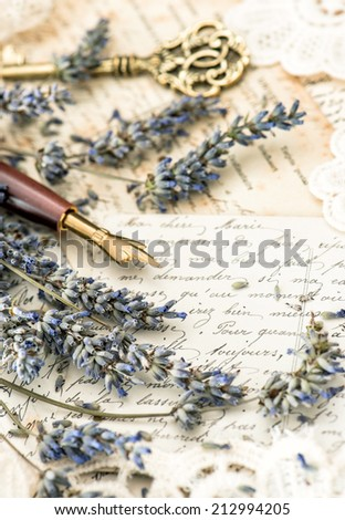 vintage ink pen, key, lavender flowers and old love letters. retro style toned picture - stock photo
