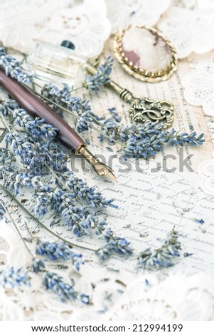 vintage ink pen, key, perfume, lavender flowers and old love letters. retro style toned picture - stock photo