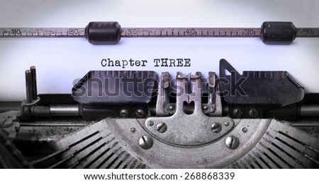 Vintage inscription made by old typewriter, chapter three - stock photo