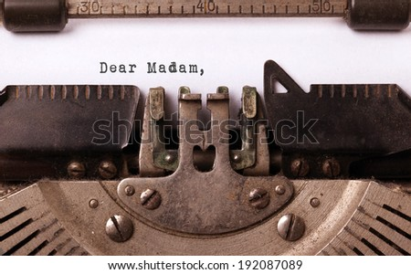 Vintage inscription made by old typewriter, dear madam - stock photo
