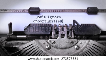 Vintage inscription made by old typewriter, Don't ignore opportunities - stock photo