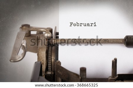 Vintage inscription made by old typewriter - Februari - stock photo