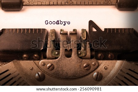 Vintage inscription made by old typewriter, goodbye - stock photo
