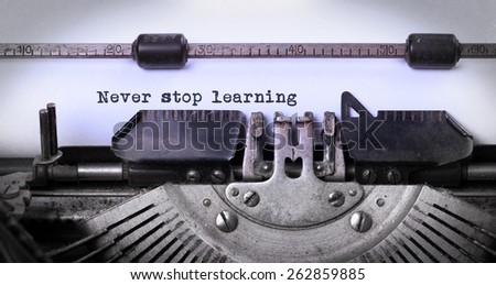 Vintage inscription made by old typewriter, never stop learning - stock photo