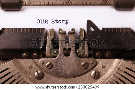 Vintage inscription made by old typewriter, our story - stock photo