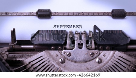 Vintage inscription made by old typewriter - September - stock photo