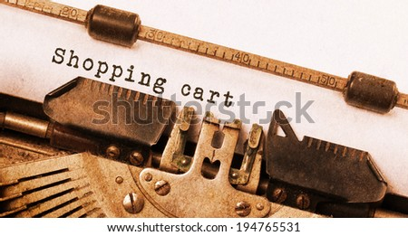 Vintage inscription made by old typewriter, shopping cart - stock photo