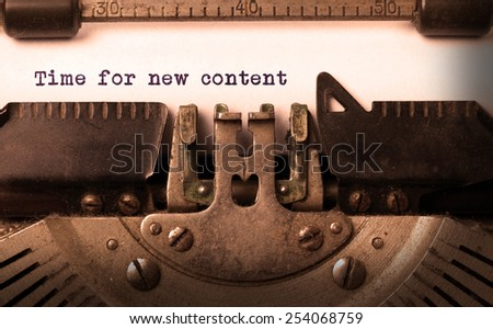Vintage inscription made by old typewriter, time for new content - stock photo