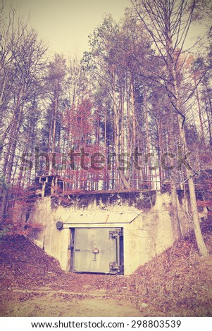 Vintage instagram filtered picture of a bunker in forest. - stock photo