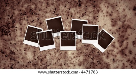 vintage instant photo frames on a rusty metal background - stock photo