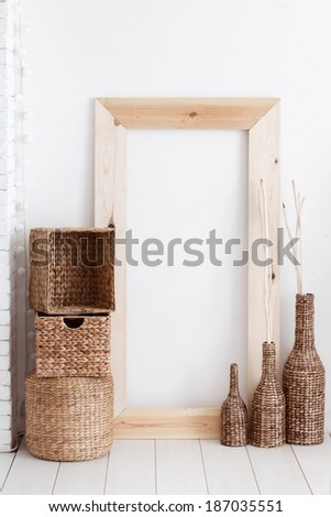 Vintage interior decor with wooden frame and wicker baskets - stock photo