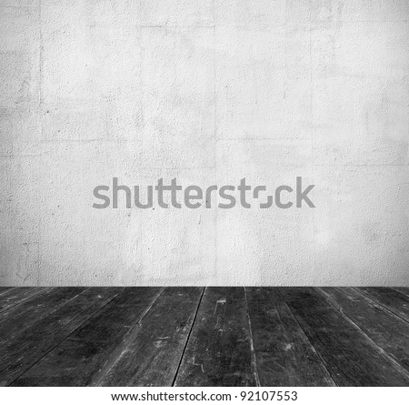 Vintage interior, grunge background of old room from white stone wall and black wooden floor - stock photo