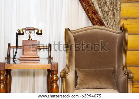 Vintage interior - telephone and armchair - stock photo