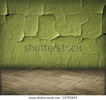 vintage interior with green cracked wall