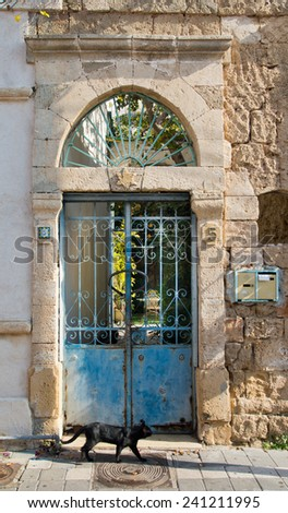 Vintage iron gates at stone villa in old town of Tel Aviv.