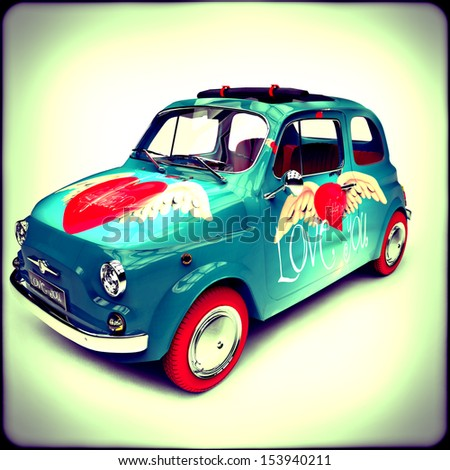 Vintage Italian car with drawings of hearts - stock photo