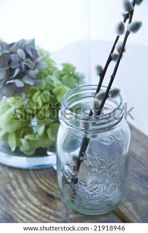 Vintage Jar sitting on a vintage table - stock photo