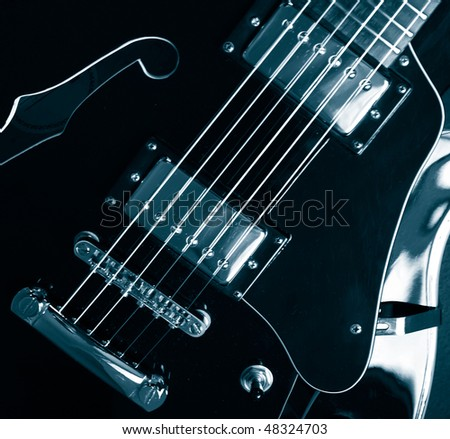 vintage jazz guitar detail monochrome in blue