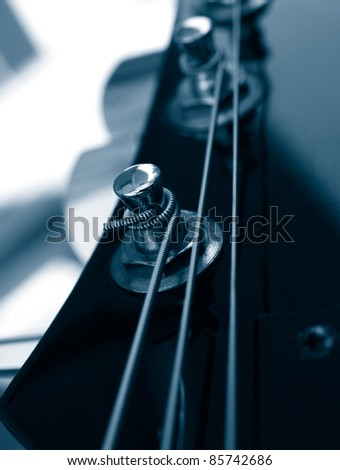 vintage jazz guitar detail monochrome in blue - stock photo