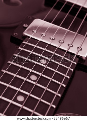 vintage jazz guitar detail monochrome in red - stock photo